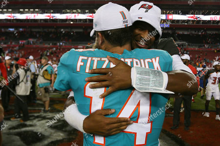 Stock Photo of Miami Dolphins quarterback Ryan Fitzpatrick (14) and Tampa Bay Buccaneers quarterback Jameis Winston (3) after the NFL preseason game between the Miami Dolphins and the Tampa Bay Buccaneers held at Raymond James Stadium in Tampa, Florida. Andrew J