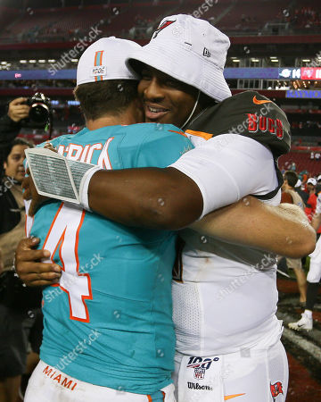 Miami Dolphins quarterback Ryan Fitzpatrick (14) and Tampa Bay Buccaneers quarterback Jameis Winston (3) after the NFL preseason game between the Miami Dolphins and the Tampa Bay Buccaneers held at Raymond James Stadium in Tampa, Florida. Andrew J