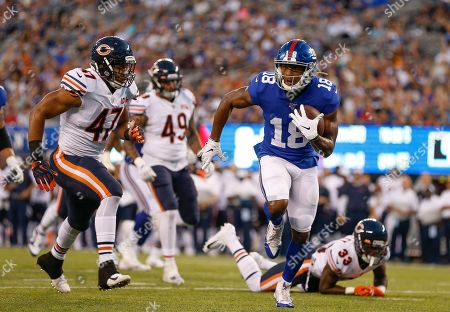 New York Giants wide receiver Bennie Fowler (18) runs for a touchdown against the Chicago Bears during the first quarter of a preseason NFL football game, in East Rutherford, N.J
