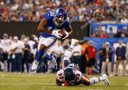 New York Giants wide receiver Bennie Fowler (18) avoids a tackle by Chicago Bears cornerback Duke Shelley (33) on his way to a touchdown against the Chicago Bears during the first quarter of a preseason NFL football game, in East Rutherford, N.J