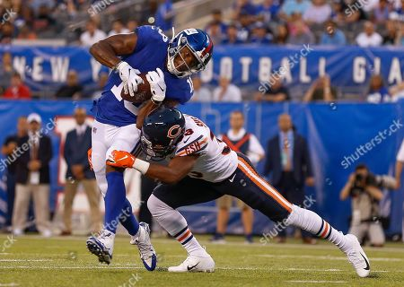 New York Giants wide receiver Bennie Fowler (18) avoids a tackle by Chicago Bears cornerback Duke Shelley (33) during the first quarter of a preseason NFL football game, in East Rutherford, N.J