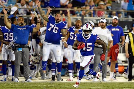 Stock Image of Buffalo Bills running back Christian Wade (45) finds some running room during the second half an NFL preseason football game against the Carolina Panthers in Charlotte, N.C