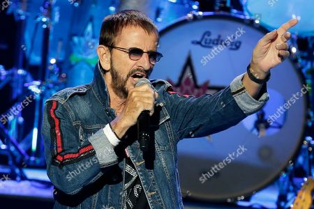 """Ringo Starr plays as part of a concert celebrating the 50th anniversary of Woodstock in Bethel, N.Y., . Tie-dyed pilgrims and white-haired Woodstock festival veterans converged at the generation-defining site to celebrate its 50th anniversary, while Arlo Guthrie came back to sing ? what else? ? """"The Times They Are a-Changin'."""" Bethel Woods Center for the Arts is hosting a series of events Thursday through Sunday at the bucolic 1969 concert site, 80 miles (130 kilometers) northwest of New York City"""
