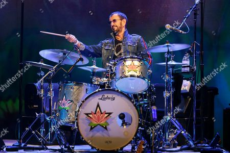 """Stock Picture of Ringo Starr plays as part of a concert celebrating the 50th anniversary of Woodstock in Bethel, N.Y., . Tie-dyed pilgrims and white-haired Woodstock festival veterans converged at the generation-defining site to celebrate its 50th anniversary, while Arlo Guthrie came back to sing ? what else? ? """"The Times They Are a-Changin'."""" Bethel Woods Center for the Arts is hosting a series of events Thursday through Sunday at the bucolic 1969 concert site, 80 miles (130 kilometers) northwest of New York City"""