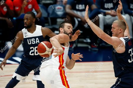 Spain center Marc Gasol (C) in action against USA forward Mason Plumlee (R) during an FIBA exhibition basketball game between the USA and Spain at the Honda Center in Anaheim, California, USA, 16 August 2019.