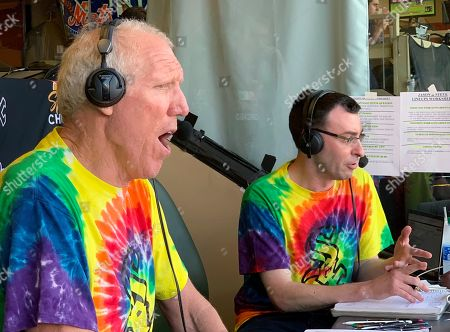 Bill Walton does commentary on NBC Sports Chicago for the Chicago White Sox's baseball game against the Los Angeles Angels, in Anaheim, Calif. Walton was calling the game on an invitation from the White Sox and announcer Jason Benetti, right