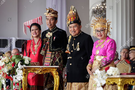 Indonesian President Joko Widodo (2-L), Vice President Jusuf Kalla (2-R) and their wives Iriana (L) and Mufidah Kalla (R), all wear traditional costumes during a flag raising ceremony to mark the 74th Independence Day at Merdeka Palace in Jakarta, Indonesia, 17 August 2019. Indonesia gained independence from the Netherlands in 1945.