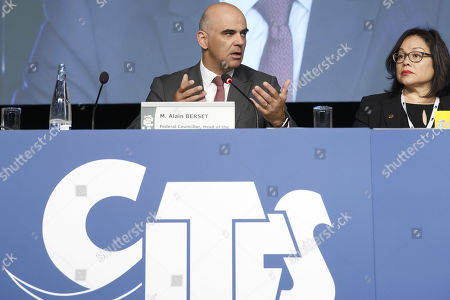 Swiss Interior Minister Alain Berset (L) sitting next to CITES Secretary-General Ivonne Higuero (R) during the opening remarks of the World Wildlife Conference - CITES CoP18, in Geneva, Switzerland, 17 August 2019. Delegates from over 180 countries gather in Geneva for Convention on International Trade in Endangered Species of Wild Fauna and Flora (CITES) conference to debate protection of species as elephants, giraffes, sharks, rhinos and some plant and tree species.
