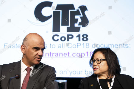 Swiss Interior Minister Alain Berset (L) chats with CITES Secretary-General Ivonne Higuero (R) during the opening remarks of the World Wildlife Conference - CITES CoP18, in Geneva, Switzerland, 17 August 2019. Delegates from over 180 countries gather in Geneva for Convention on International Trade in Endangered Species of Wild Fauna and Flora (CITES) conference to debate protection of species as elephants, giraffes, sharks, rhinos and some plant and tree species.