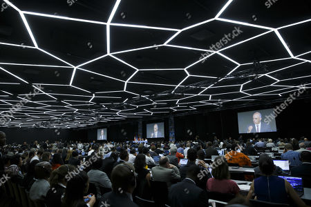Swiss Interior Minister Alain Berset is seen on screens as he delivers his statement during the opening remarks of the World Wildlife Conference - CITES CoP18, in Geneva, Switzerland, 17 August 2019. Delegates from over 180 countries gather in Geneva for Convention on International Trade in Endangered Species of Wild Fauna and Flora (CITES) conference to debate protection of species as elephants, giraffes, sharks, rhinos and some plant and tree species.