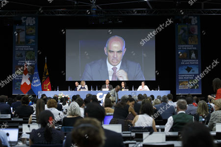 Swiss Interior Minister Alain Berset (C) sitting next to Executive Director of the United Nations Environment Programme Inger Andersen (L) and CITES Secretary-General Ivonne Higuero (2-R) during the opening remarks of the World Wildlife Conference - CITES CoP18, in Geneva, Switzerland, 17 August 2019. Delegates from over 180 countries gather in Geneva for Convention on International Trade in Endangered Species of Wild Fauna and Flora (CITES) conference to debate protection of species as elephants, giraffes, sharks, rhinos and some plant and tree species.