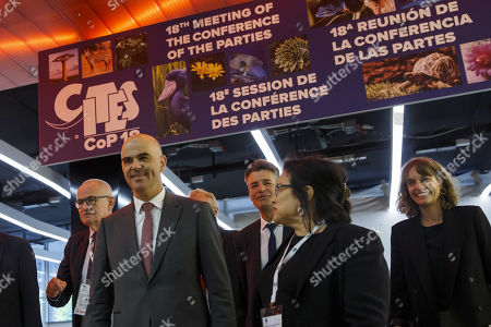 Swiss Interior Minister Alain Berset (L) and CITES Secretary-General Ivonne Higuero (R) arrive for the opening of the World Wildlife Conference - CITES CoP18, in Geneva, Switzerland, 17 August 2019. Delegates from over 180 countries gather in Geneva for Convention on International Trade in Endangered Species of Wild Fauna and Flora (CITES) conference to debate protection of species as elephants, giraffes, sharks, rhinos and some plant and tree species.
