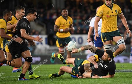 Sonny Bill Williams (2-R) of the All Blacks passes to Anton Lienert-Brown of the All Blacks (3-L)  during the Bledisloe Cup match between the New Zealand All Blacks and the Australian Wallabies  at Eden Park in Auckland, New Zealand, 17 August 2019.