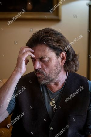 Stock Photo of British music and composer Alan Parsons ponders during an interview in Jerez de la Frontera, Southern Spain, 17 August 2019. Parsons will be performing during the closure of the Tio Pepe Festival, during his unique concert in Spain this year later on 17 August 2019.