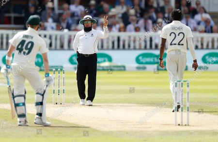 Umpire Aleem Dar warns England's bowler Jofra Archer that he has bowled two delivers above head height during play on day four of the 2nd Ashes Test cricket match between England and Australia at Lord's cricket ground in London