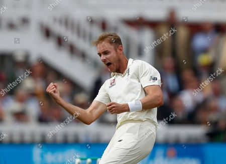 England's Stuart Broad celebrates after taking the wicket of Australia's Matthew Wade caught, on day four of the 2nd Ashes Test cricket match between England and Australia at Lord's cricket ground in London