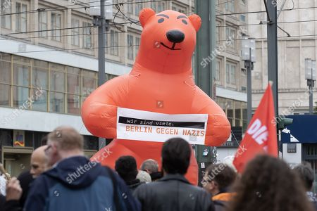 A big inflatable balloon of the Berlin Bear holding a placard reading 'We are many, Berlin against Nazis' is seen during a protest against a neo-Nazi march commemorating Rudolf Hess, at the Alexanderplatz in Berlin, Germany, 17 August 2019. The annual neo-Nazi march to mark the death of Hitler's deputy Rudolf Hess started in 2002 when fifteen years after the death of Hess, between 2,500 and 3,000 Neo-Nazis from all over Europe met at Hess's grave in the small German town of Wunsiedel.