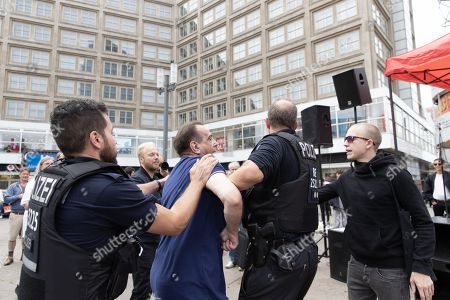 Police officers arrest a man for a violence to demonstrators during a protest against a neo-Nazi march commemorating Rudolf Hess, at the Alexanderplatz in Berlin, Germany, 17 August 2019. The annual neo-Nazi march to mark the death of Hitler's deputy Rudolf Hess started in 2002 when fifteen years after the death of Hess, between 2,500 and 3,000 Neo-Nazis from all over Europe met at Hess's grave in the small German town of Wunsiedel.