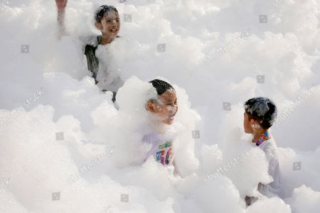 Children enjoy running in a cloud of foam during the 'Sesame Street Run' in Manila, Philippines, 17 August 2019. The Sesame Street Run is a family run catered for all ages to celebrate the 50 years anniversary of the educational 'Sesame Street' show featuring the fluffy characters called muppets by US puppeteer Jim Henson. The Sesame Street Run will travel and also be held in Thailand, Malaysia, Indonesia, and Singapore. 'Sesame Street' premiered on US television on 10 November 1969.