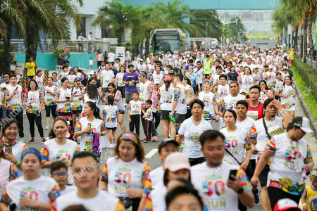 People participate in the 'Sesame Street Run' in Manila, Philippines, 17 August 2019. The Sesame Street Run is a family run catered for all ages to celebrate the 50 years anniversary of the educational 'Sesame Street' show featuring the fluffy characters called muppets by US puppeteer Jim Henson. The Sesame Street Run will travel and also be held in Thailand, Malaysia, Indonesia, and Singapore. 'Sesame Street' premiered on US television on 10 November 1969.