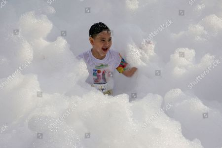 A child enjoys running in a cloud of foam during the 'Sesame Street Run' in Manila, Philippines, 17 August 2019. The Sesame Street Run is a family run catered for all ages to celebrate the 50 years anniversary of the educational 'Sesame Street' show featuring the fluffy characters called muppets by US puppeteer Jim Henson. The Sesame Street Run will travel and also be held in Thailand, Malaysia, Indonesia, and Singapore. 'Sesame Street' premiered on US television on 10 November 1969.