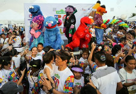 People interact with characters from the Sesame Street show during the 'Sesame Street Run' in Manila, Philippines, 17 August 2019. The Sesame Street Run is a family run catered for all ages to celebrate the 50 years anniversary of the educational 'Sesame Street' show featuring the fluffy characters called muppets by US puppeteer Jim Henson. The Sesame Street Run will travel and also be held in Thailand, Malaysia, Indonesia, and Singapore. 'Sesame Street' premiered on US television on 10 November 1969.