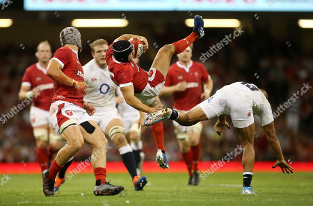 Leigh Halfpenny of Wales crashes to the ground after going for the high ball with Jonathan Joseph of England.
