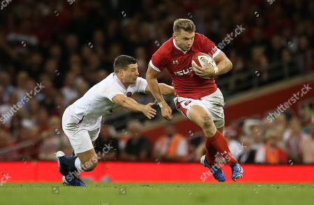 Dan Biggar of Wales gets past Ben Youngs of England.