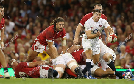 Josh Navidi of Wales looks on as Ben Youngs of England feeds the ball out.