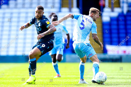 Jonson Clarke-Harris of Bristol Rovers takes on Kyle McFadzean of Coventry City