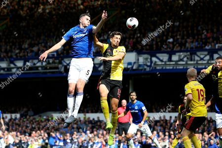 Everton defender Michael Keane (5) and Watford defender Craig Cathcart (15) during the Premier League match between Everton and Watford at Goodison Park, Liverpool