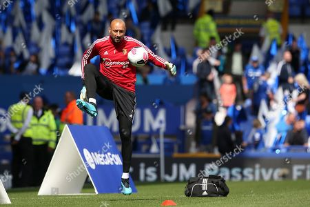 Watford goalkeeper Heurelho Gomes (1)  warming up during the Premier League match between Everton and Watford at Goodison Park, Liverpool
