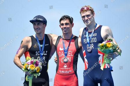 (L-R) Martin Schulz (GER), Stefan Daniel (CAN), George Peasgood (GBR) - ITU Para Triathlon World Cup Tokyo Men's PTS5 Award ceremony
