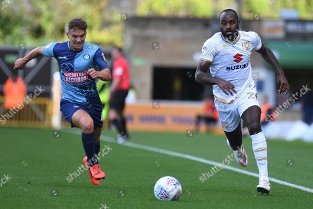 Milton Keynes Dons midfielder Hiram Boateng (26) sprints forward with the ball chased by Wycombe Wanderers midfielder Dominic Gape (4) during the EFL Sky Bet League 1 match between Wycombe Wanderers and Milton Keynes Dons at Adams Park, High Wycombe