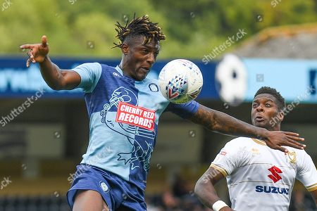 Wycombe Wanderers defender Anthony Stewart (5) heads the ball during the EFL Sky Bet League 1 match between Wycombe Wanderers and Milton Keynes Dons at Adams Park, High Wycombe