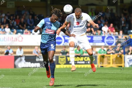 Milton Keynes Dons forward Jordan Bowery (9) heads the ball  under pressure from Wycombe Wanderers defender Anthony Stewart (5) during the EFL Sky Bet League 1 match between Wycombe Wanderers and Milton Keynes Dons at Adams Park, High Wycombe
