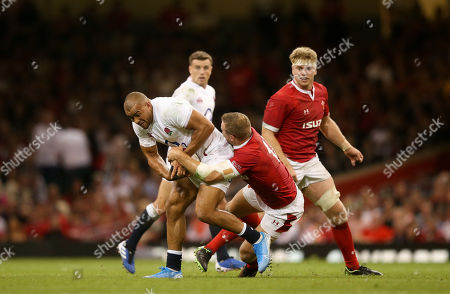 Jonathan Joseph of England held by Hadleigh Parkes of Wales
