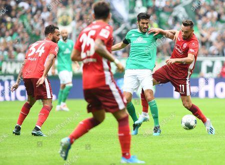 Bremen's Nuri Sahin (C) in action against Duesseldorf's Kenan Karaman (R) during the German Bundesliga soccer match between SV Werder Bremen and Fortuna Duesseldorf in Bremen, Germany, 17 August 2019.