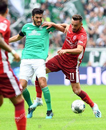 Bremen's Nuri Sahin (L) in action against Duesseldorf's Kenan Karaman (R) during the German Bundesliga soccer match between SV Werder Bremen and Fortuna Duesseldorf in Bremen, Germany, 17 August 2019.