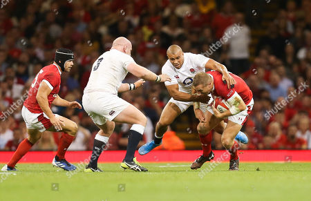 Hadleigh Parkes of Wales is caught by Jonathan Joseph of England