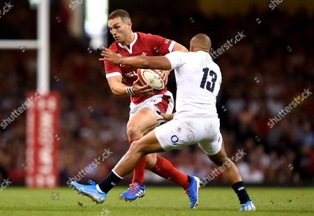 George North of Wales is tackled by Jonathan Joseph of England.