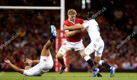 Aaron Wainwright of Wales is tackled by Jonathan Joseph and Piers Francis of England.
