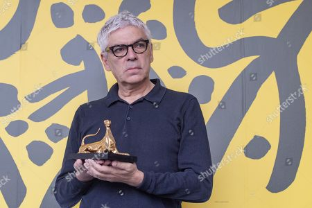 """Pedro Costa from Portugal poses with the ''Pardo d'oro'' trophy for the best Film """"Vitalina Varela"""" during the photocall at the 72th Locarno International Film Festival in Locarno, Switzerland, 17 August 2019. The Festival del film Locarno runs from 07 to 17 August 2019."""