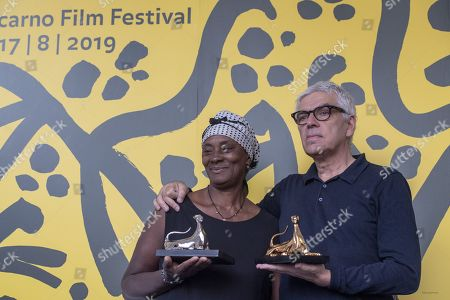 """Pedro Costa (R) from Portugal poses with the ''Pardo d'oro'' trophy for the best Film with actress Vitalina Varela (L) from Cabo Verde for the """"best actress"""" from the Film """"Vitalina Varela """" during the photocall at the 72th Locarno International Film Festival in Locarno, Switzerland, 17 August 2019. The Festival del film Locarno runs from 07 to 17 August 2019."""
