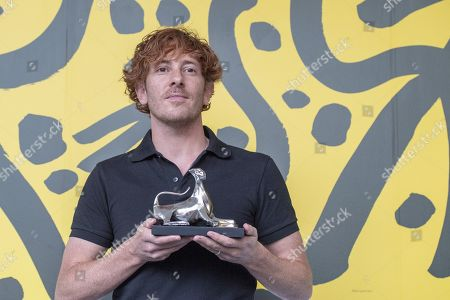 """Stock Image of Damien Manivel from France poses with the ''Leopard for Best Direction'' for the Film """"Les Enfants d Isadora"""" during the photocall at the 72th Locarno International Film Festival in Locarno, Switzerland, 17 August 2019. The Festival del film Locarno runs from 07 to 17 August 2019."""