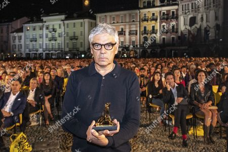 Pedro Costa from Portugal poses with the 'Pardo d'oro' trophy for the best Film 'Vitalina Varela' on the Piazza Grande at the 72th Locarno International Film Festival in Locarno, Switzerland, 17 August 2019. The Festival del film Locarno runs from 07 to 17 August 2019.