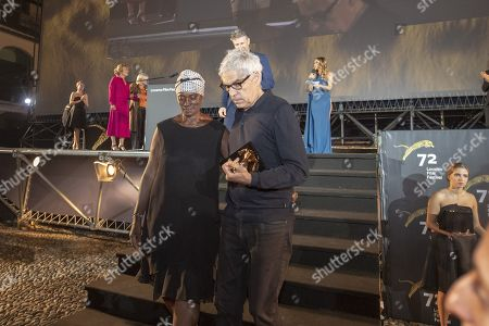 """Pedro Costa (R) from Portugal with the ''Pardo d'oro'' trophy for the best Film with actress Vitalina Varela from Cabo Verde for the """"best actress"""" from the Film """"Vitalina Varela """" on the Piazza Grande at the 72th Locarno International Film Festival in Locarno, Switzerland, 17 August 2019. The Festival del film Locarno runs from 07 to 17 August 2019."""