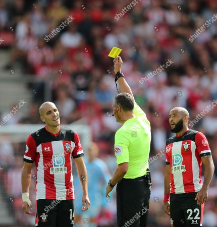 Oriol Romeu of Southampton receives a yellow card from Referee Andre Marriner.