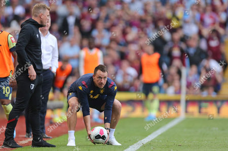 Assistant Head Coach John Terry is quick to get the ball back into play during Aston Villa vs AFC Bournemouth, Premier League Football at Villa Park on 17th August 2019