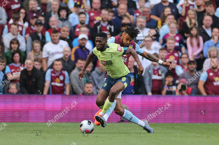 Tyrone Mings of Aston Villa in action tackles Jefferson Lerma of Bournemouth.